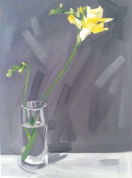Yellow freesias in a glass